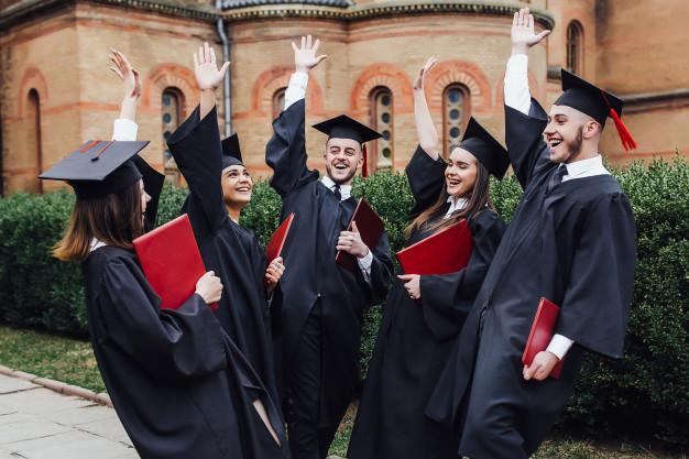 happy-college-graduate-show-diplomas-ceremony-outside-university_115086-937