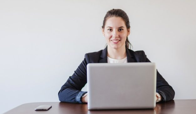 woman-sitting-desk-working-laptop_23-2147650965